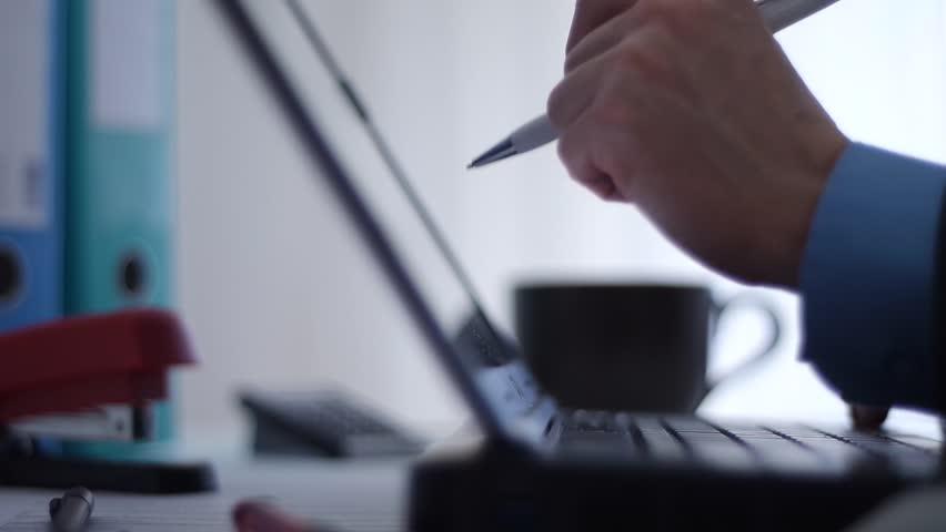 Working on laptop   Shutterstock HD Video #14756236