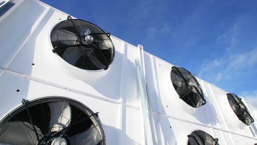 New Industrial large air conditioning fans on the background of blue sky