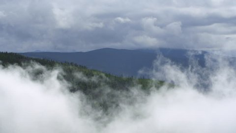 AERIAL MS Mountains in clouds / Rocky Mountains, USA