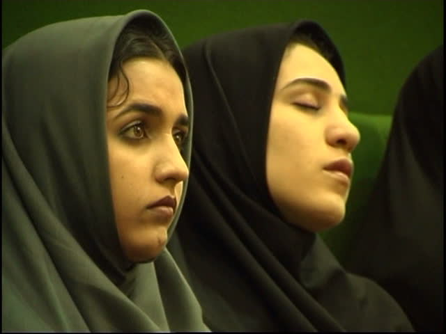Parliament, Tehran, Iran - 2005 - Clip of two girls in the public gallery listening to an MP speaking. One girl is fast asleep while the other girl is listening.