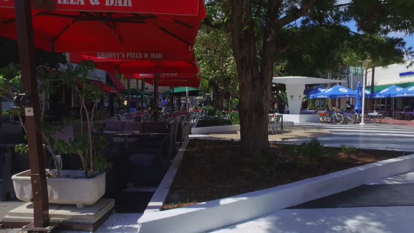 MIAMI BEACH - FEBRUARY 25: Scene at Lincoln Road Miami Beach which is an open air promenade with shops, restaurants and art galleries February 25, 2016 in Miami Beach FL | Shutterstock HD Video #14825545