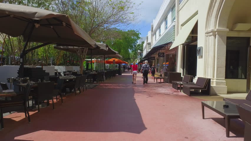 MIAMI BEACH - FEBRUARY 25: Scene at Lincoln Road Miami Beach which is an open air promenade with shops, restaurants and art galleries February 25, 2016 in Miami Beach FL | Shutterstock HD Video #14825548