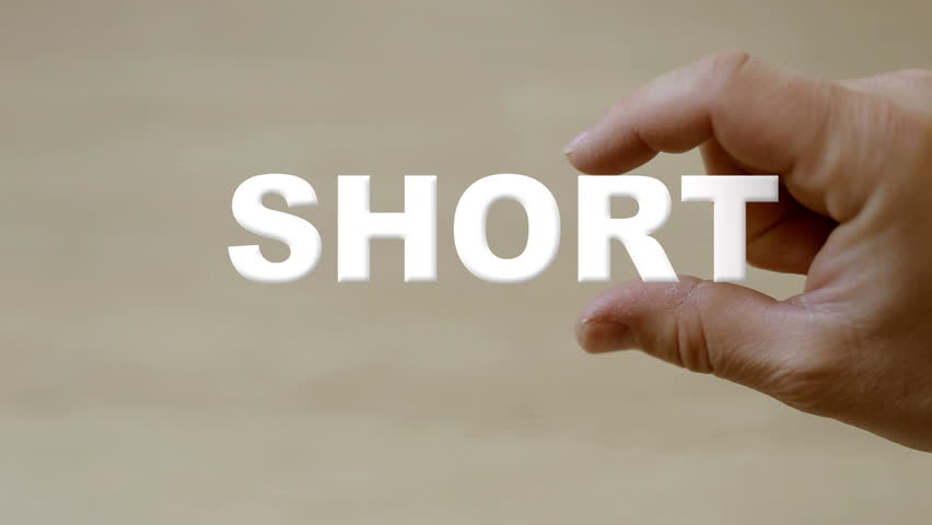 Shot of Hand holding the word SHORT | Shutterstock HD Video #14840968