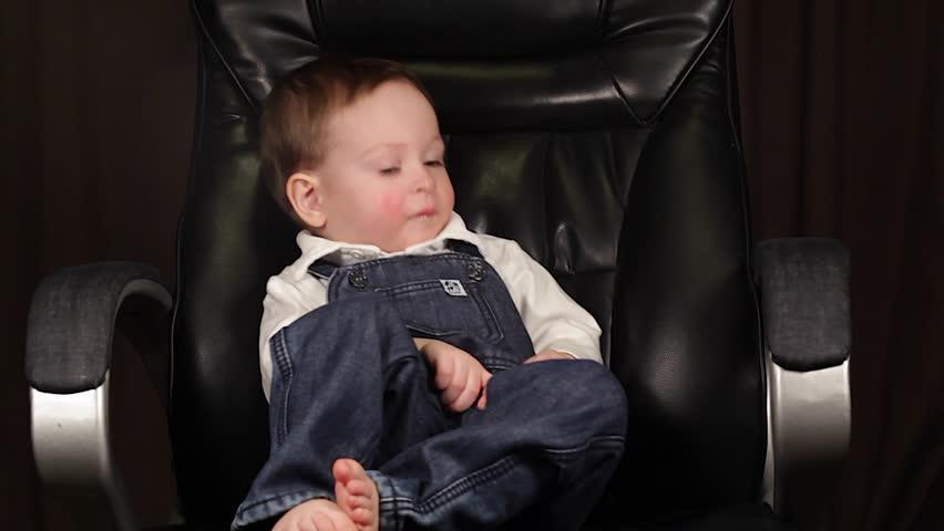 Happy boy on a chair