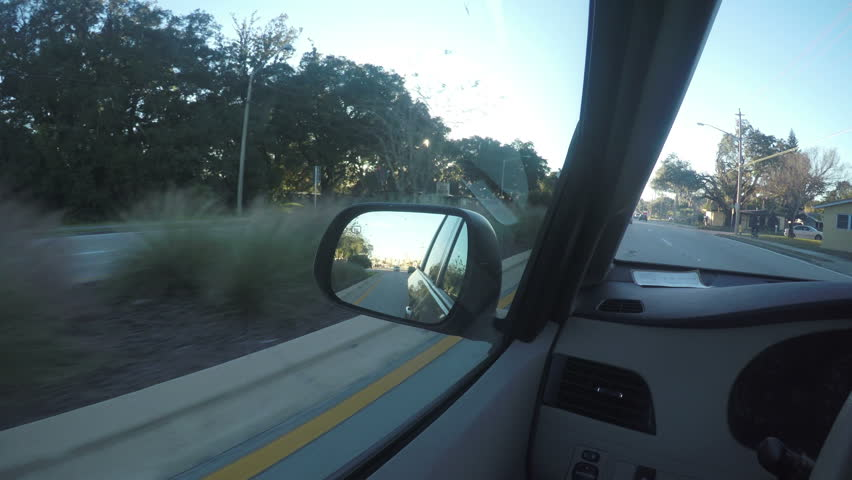 Driving in Car Looking out Rearview Mirror with Sun Flare | Shutterstock HD Video #14851282