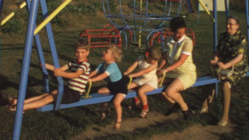 Mother, grandma and children on swing (vintage 8 mm film) #1486396
