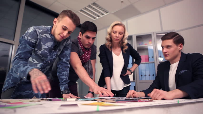 A group of young designers led by the head are working on the project of design business center, private home, studio, shop, office/Designers at Work | Shutterstock HD Video #14874826
