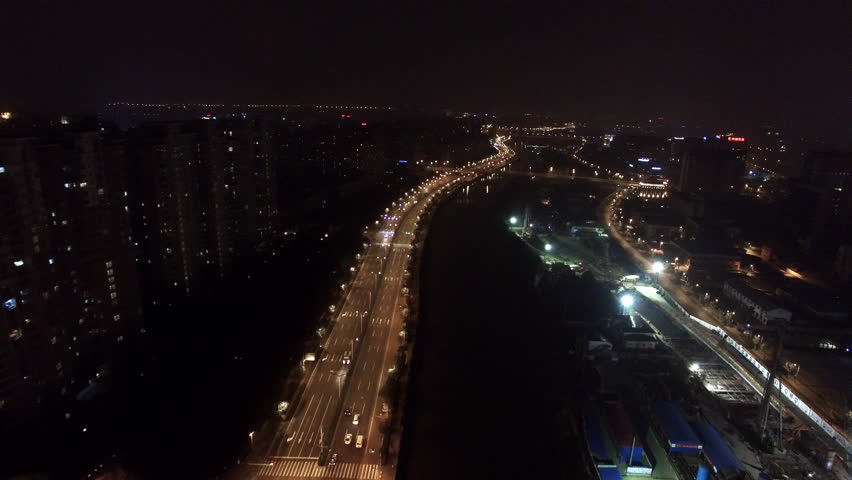 Aerial night shot of cars driving on a road along a river | Shutterstock HD Video #14879479