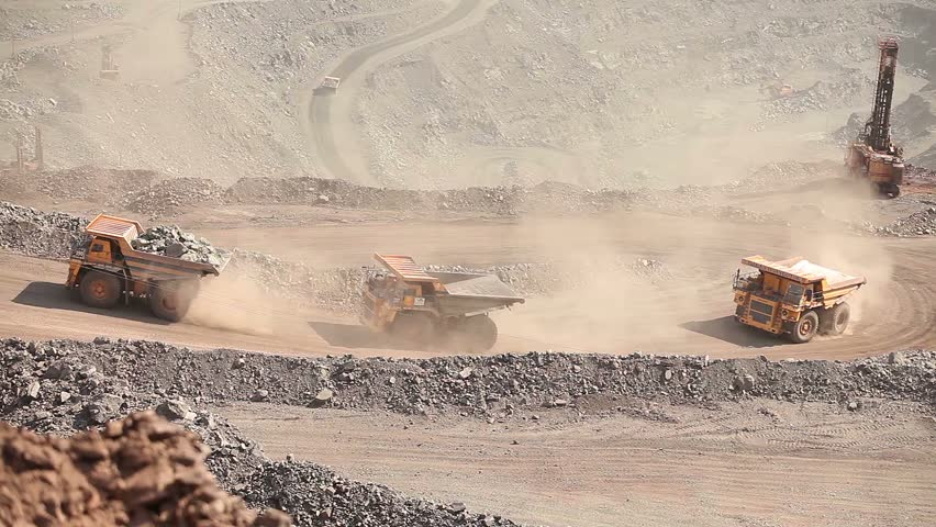 Heavy mining truck on the iron ore opencast mining quarry, three trucks driven by iron ore in career, industrial exterior, ore mining quarry, sunny day, summer, mining of iron