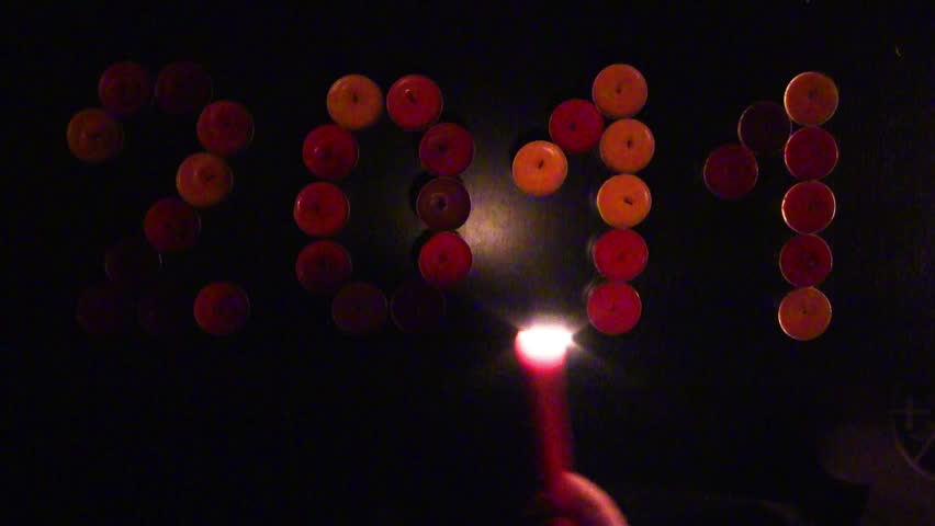 2011/2012 made of colored candles on a black background