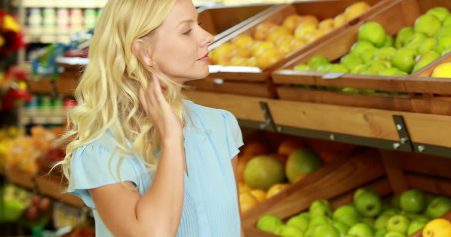 Portrait of smiling blonde picking lemons in grocery store | Shutterstock HD Video #14931235