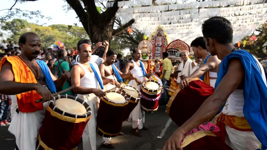 Cochin, India - January 1, 2016: Kathakali dancer and drams performing on the streets of Fort Kochi during New Year Parade. Cochin Carnival held in the last week of December in Kerala since 1984.