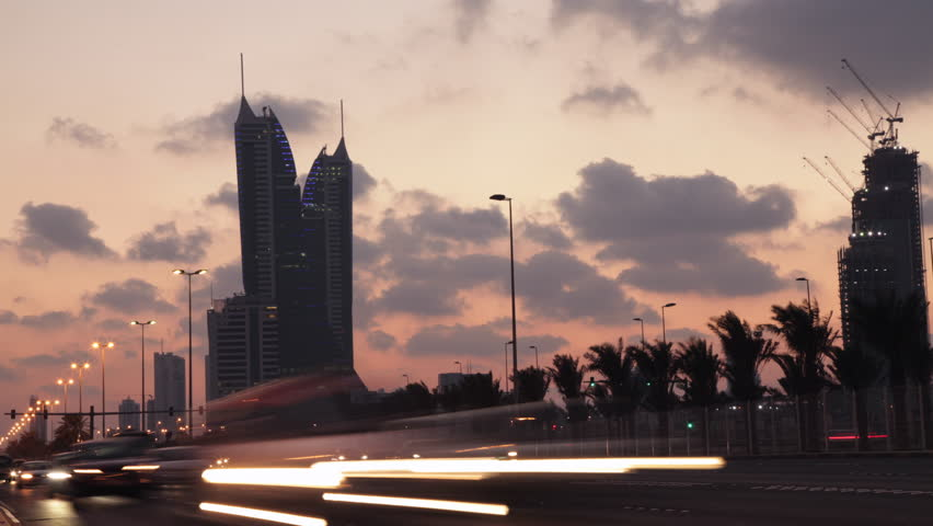 Traffic on a highway during dusk in Bahrain - Time lapse. King Faisal Highway.