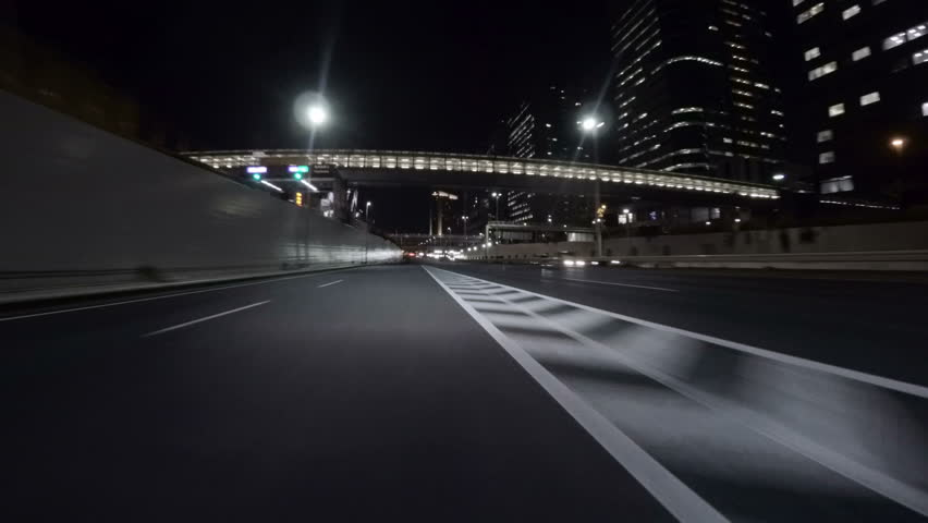 Midnight drive through the empty Tokyo Bayshore Highway through the modern creations over reclaimed lands in Odaiba. | Shutterstock HD Video #14964940