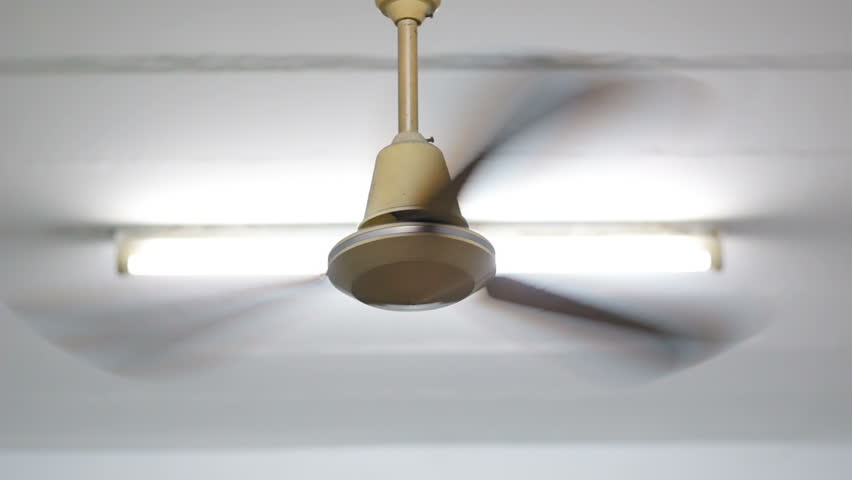 Old Style Ceiling Fan Spins Stock