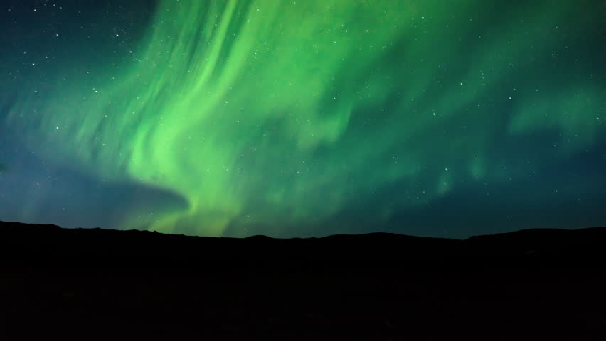 4K timelapse of beautiful natural phenomena of aurora borealis northern lights, artic light show by electric charged particles colliding with atmosphere