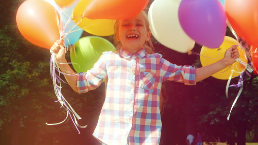 Closeup portrait girl jumping with balloons and spinning and laughing at camera. Sunlight  | Shutterstock HD Video #15037888