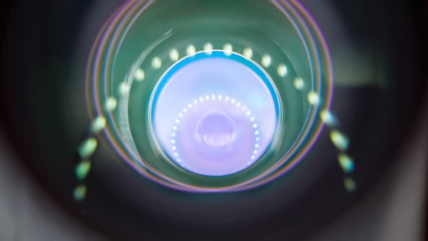 The camera moves downwards and in the lens reflected circular light sources. Closeup. Shallow depth of field. Color correction