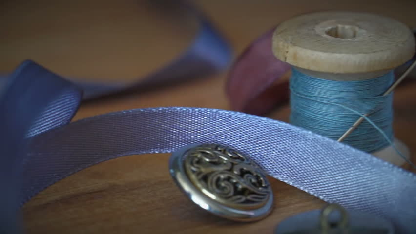 Sewing supplies scattered on the table | Shutterstock HD Video #15062245