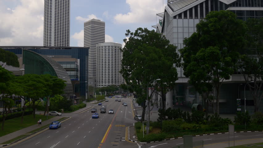 SINGAPORE - JANUARY 2016: raffles ave suntec city mall marina square traffic bridge panorama circa january 2016 singapore.   Shutterstock HD Video #15065653