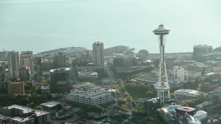 Seattle's Space Needle with sun reflection at dusk - Aerial view Royalty-Free Stock Footage #1506989