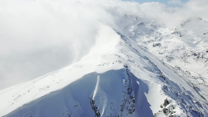 Beautiful White Snowy Mountain Range Epic Scale Swiss Aerial Footage Extreme Travel Winter Landscape Ski Sports Concept UHD 4K
