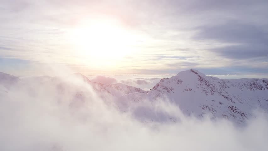 Aerial Flight Through Clouds Toward Sunset In The Mountains Winter Snow Landscape Inspirational Morning Sunlight Mist Inspiration Concept UHD 4K #15072103
