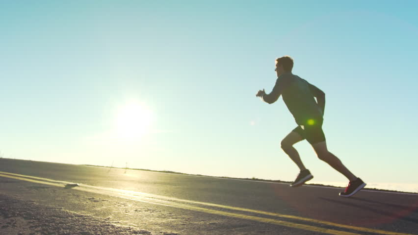 Slow Motion Male athlete exercising outdoors. Sports and active lifestyle. Male runner silhouette, Man running into sunset, colorful sunset sky. | Shutterstock HD Video #15078082