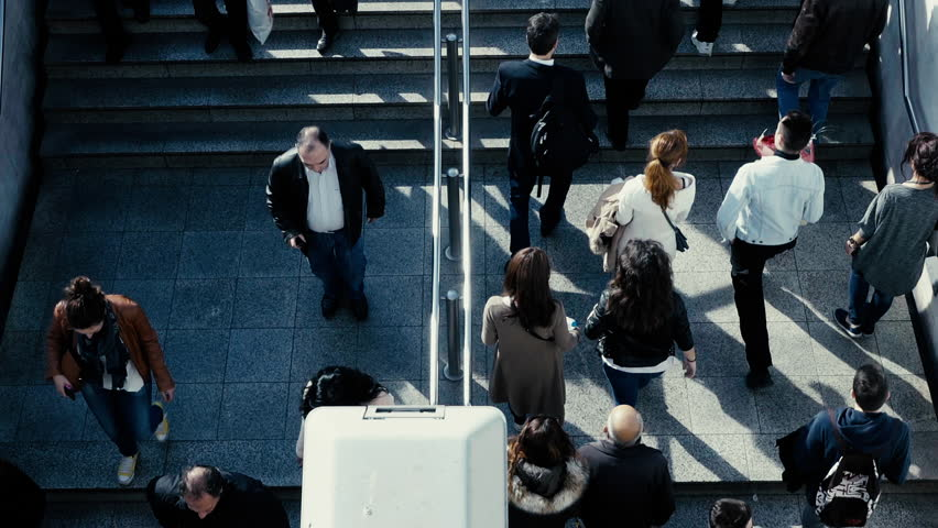 Birds eye view dolly slow motion people walk steps from/to underground entrance.100-25p super slomo dolly overhead tracking of people walking to the underground train station.No logos/faces visible. | Shutterstock HD Video #15081154