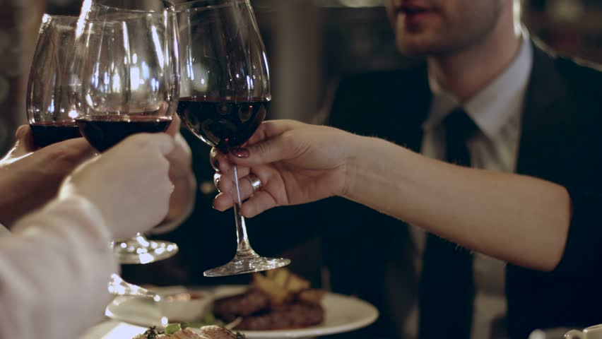 Family members raised their glasses with wine at the festive dinner    Shutterstock HD Video #15094951