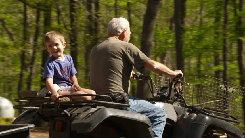 4k Grandpa and Grandson riding a 4 wheeler on the farm Slow motion stock video clip   Shutterstock HD Video #15102898
