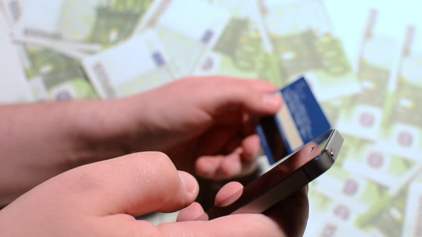 Using Mobile Smartphone Technology And Credit Card and Money | Shutterstock HD Video #15114649