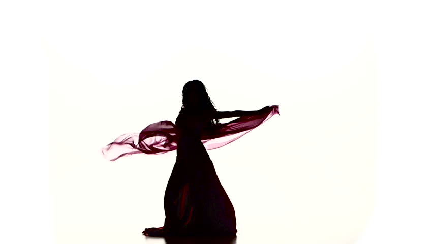 Pretty young girl dancing belly dance with colored shawl, on white, slow motion