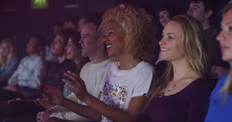 4K Young theatre audience give a standing ovation to the performers on stage