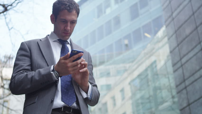 4k Ecstatic businessman gets news of a successful business deal via his phone #15128209