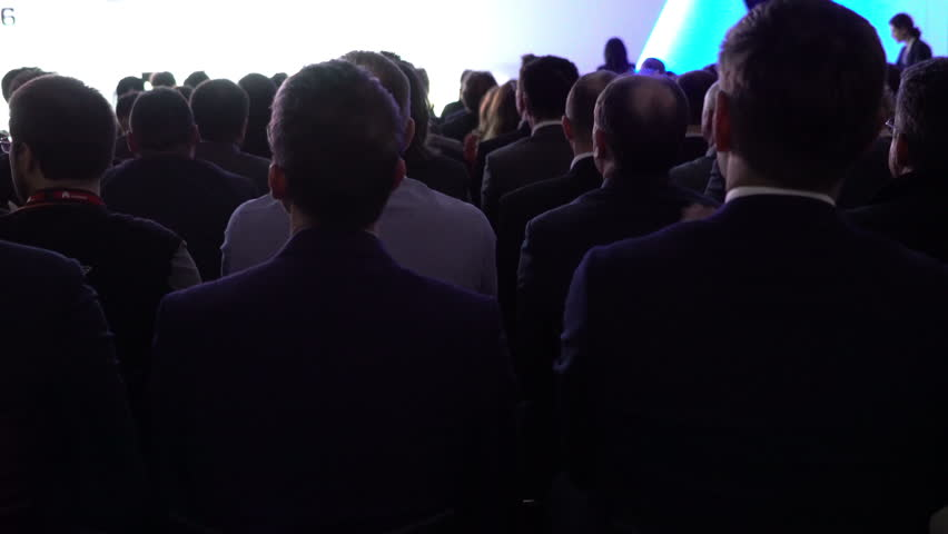 Business Man Conference or Congress. Audience Spectators People Attending Man speaking to people attending audience spectators. Mwc 4K UHD