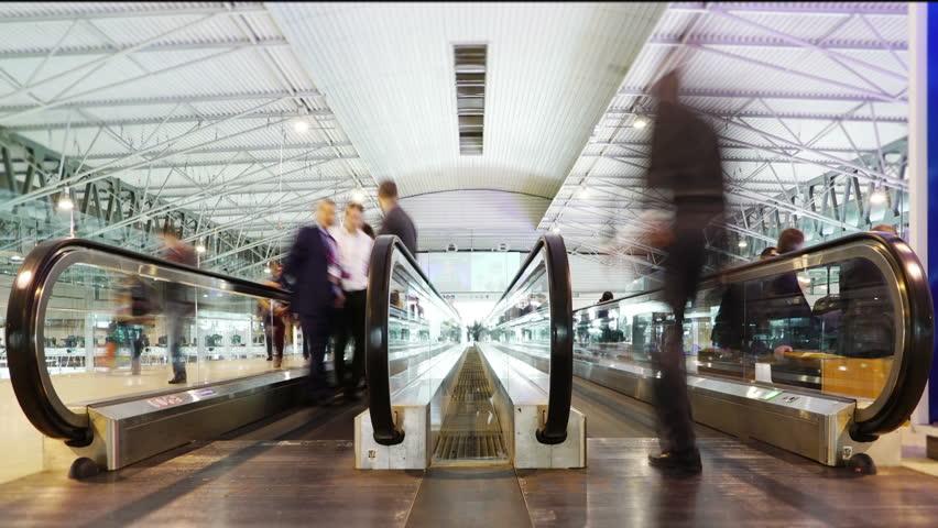 Conveyor Belt People Crowd. Business Man Woman crossing a big hall in escalators Belt Conveyor Treadmill.