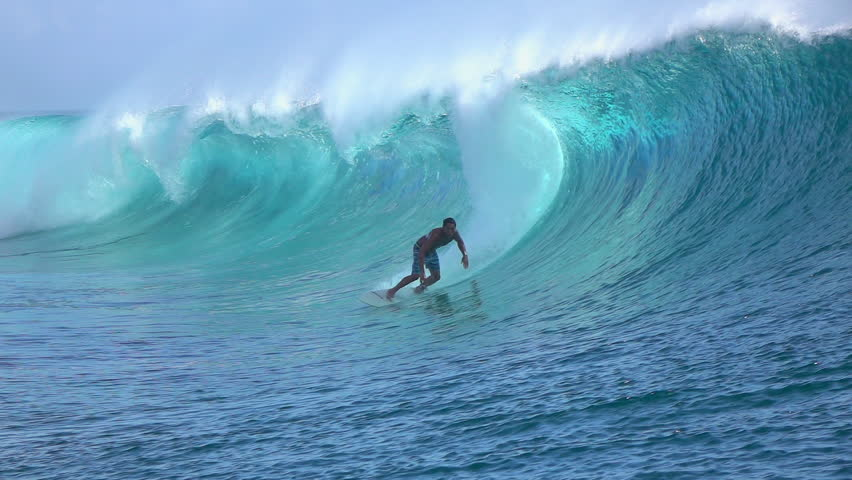 SLOW MOTION: Cheerful extreme pro surfer surfing big tube barrel wave Teahupoo in crystal clear Pacific ocean in sunny Tahiti island