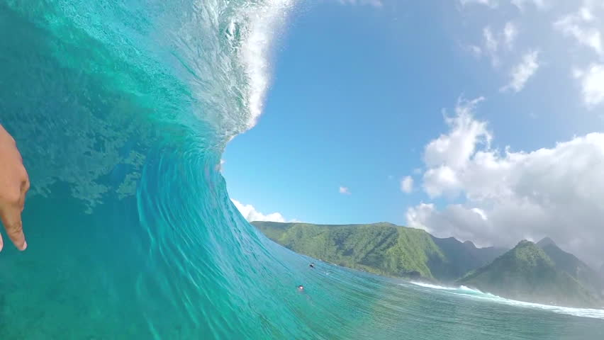 FPV SLOW MOTION: Pro surfer paddling and surfing big barrel wave Teahupoo in famous surf spot in sunny Tahiti island