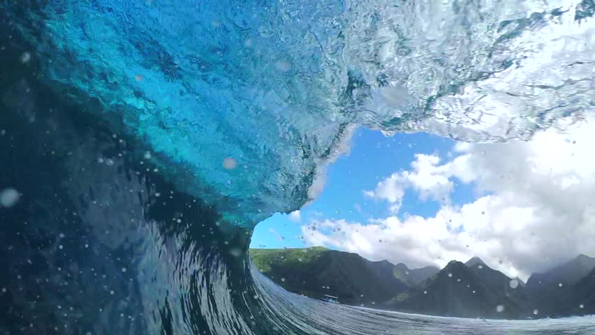 FPV SLOW MOTION: Extreme pro surfer surfing big tube barrel wave Teahupoo in crystal clear Pacific ocean in sunny Tahiti island