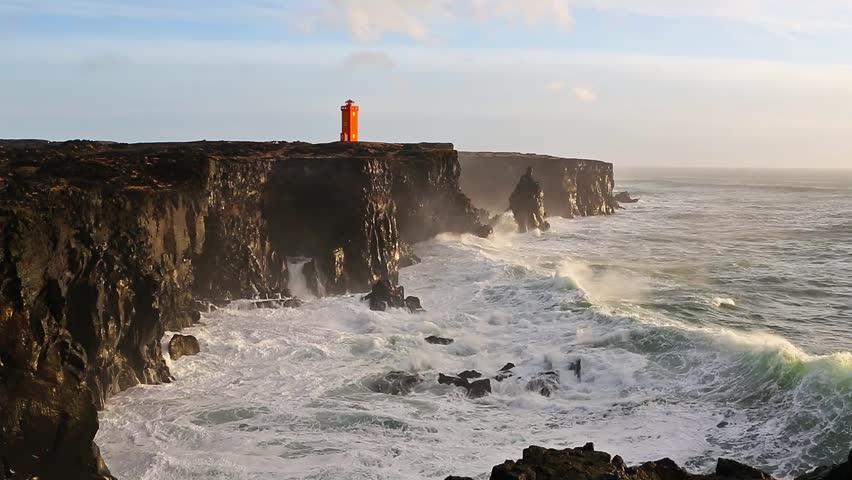 Waves breaking on the black rock cliff of western Icelandic coast, Snaefellsnes Peninsulain, Iceland   Shutterstock HD Video #15160018