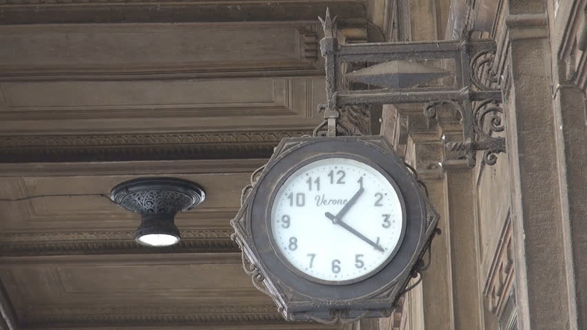 BOLOGNA, ITALY- JUNE 8, 2011, Beautiful ancient public clock hang in old town by day