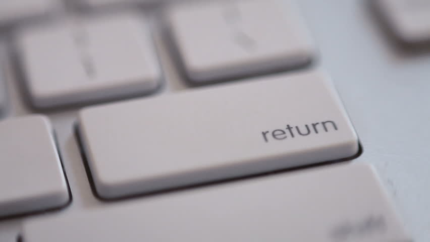 An extreme close up of a finger pressing the RETURN key once, then furiously. #1516243