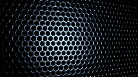 Dark metal background with perforated holes.