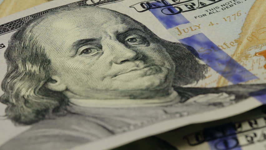 Cash money background. Benjamin Franklin portrait on 100 US dollar bill close up, the image is rotated | Shutterstock HD Video #15170089
