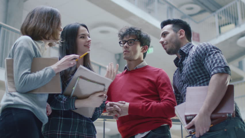 Group of young multi-ethnic students are having a conversation in an university lobby. Shot on RED Cinema Camera in 4K (UHD). | Shutterstock HD Video #15179824
