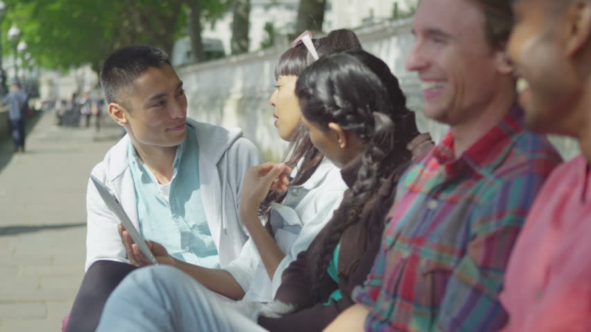 4K Portrait of happy mixed ethnicity group of friends hanging out in the city. | Shutterstock HD Video #15183055