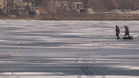Barrie, Ontario, Canada March 2016 Dangerous thin unsafe ice in with people on it in Barrie Canada