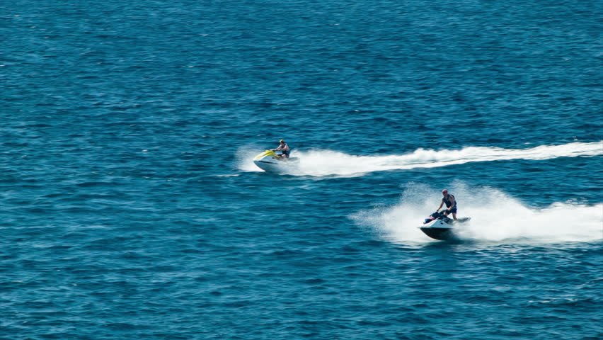 Guys Riding Jet Skis on Blue Ocean Water during an Excursion on a Sunny Day in the Mexican Riviera near Cabo San Lucas #15186586