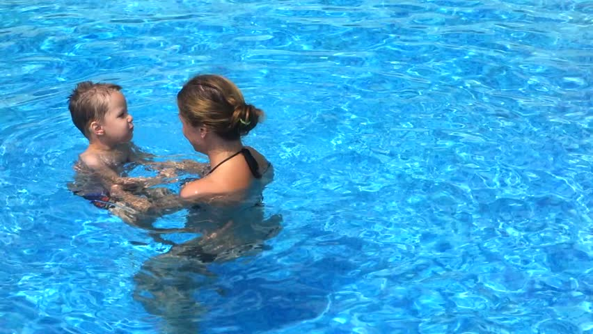 Mother with her son in the pool   Shutterstock HD Video #15187159